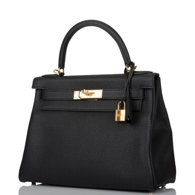View 4. Thumbnail of Lot 52. HERMÈS   BLACK RETOURNE KELLY 28CM OF TOGO LEATHER WITH GOLD HARDWARE.