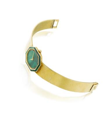 View 2. Thumbnail of Lot 74. Piaget | Montre de dame or et malachite | Lady's gold and malachite bracelet watch.