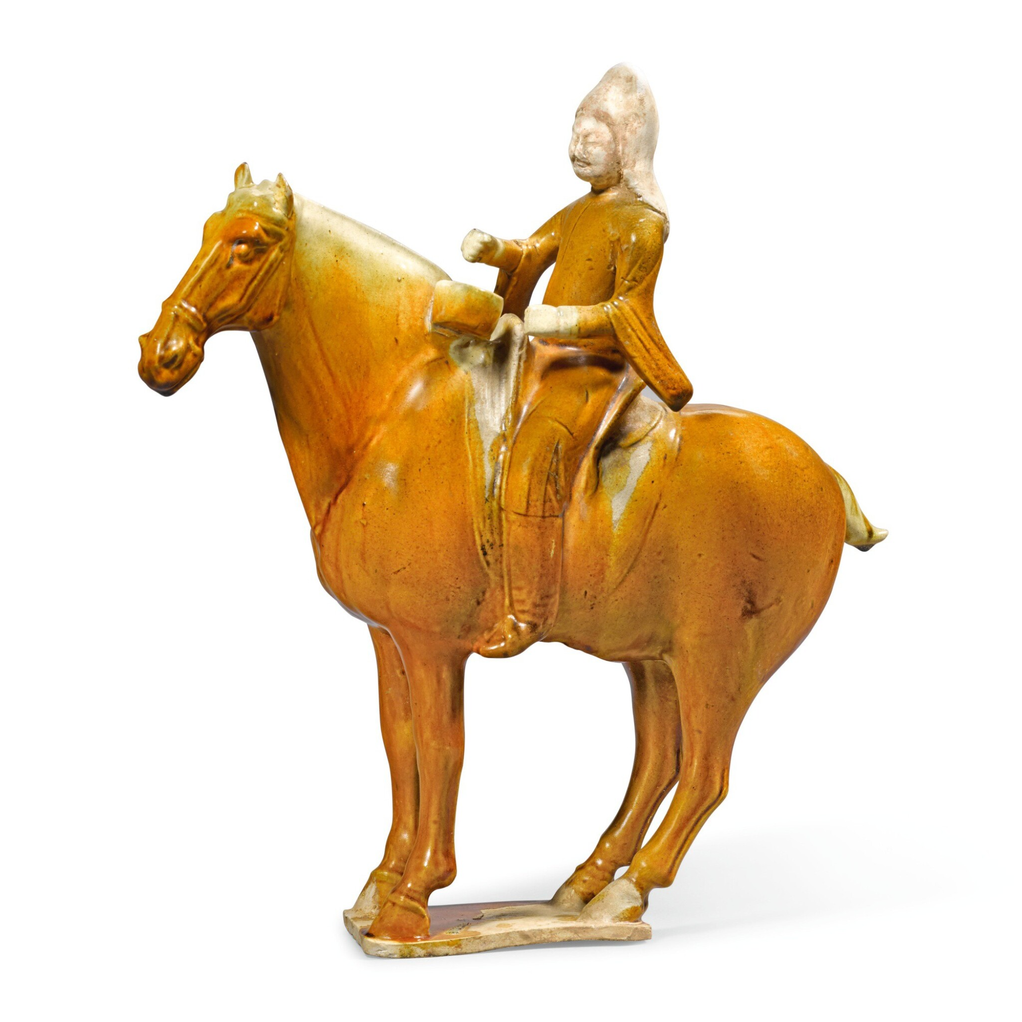 View full screen - View 1 of Lot 211. A RARE AMBER-GLAZED FIGURE OF AN EQUESTRIAN DRUMMER, TANG DYNASTY | 唐 黃釉胡人騎馬陶俑.