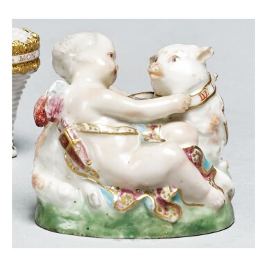 View 1. Thumbnail of Lot 22.  A CHELSEA PORCELAIN BONBONNIERE IN THE FORM OF CUPID WITH A SHEEP CIRCA 1760  .