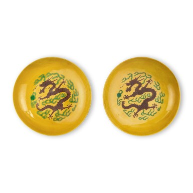 View 1. Thumbnail of Lot 7. A pair of yellow-ground green and aubergine-enameled 'dragon' dishes, Marks and period of Guangxu.