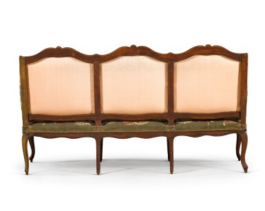 View 7. Thumbnail of Lot 78. A Louis XV suite of carved beechwood seat furniture by Michel Cresson, mid-18th century.
