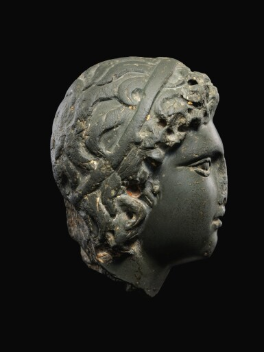 View 2. Thumbnail of Lot 26. A ROMAN GRAYWACKE HEAD OF A YOUTH, CIRCA 2ND CENTURY A.D..