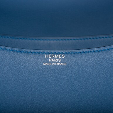 View 8. Thumbnail of Lot 18.  Hermès Bleu Agate Constance 24cm of Swift Leather with Palladium Hardware.