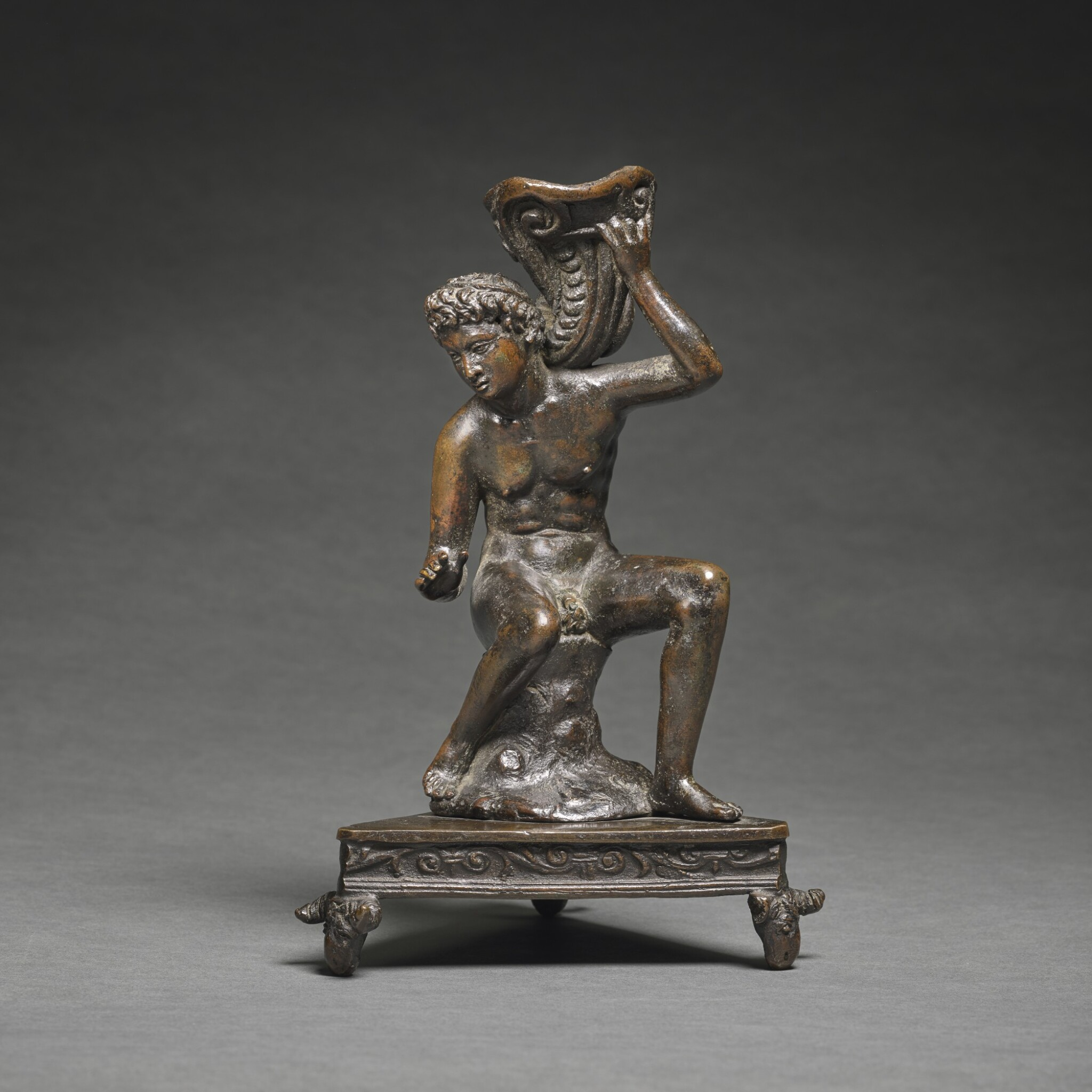 After Andrea Briosco, called Riccio (circa 1470-1532), Italian, Padua, second quarter 16th century | Inkwell in the form of a Seated Youth holding a Cornucopia