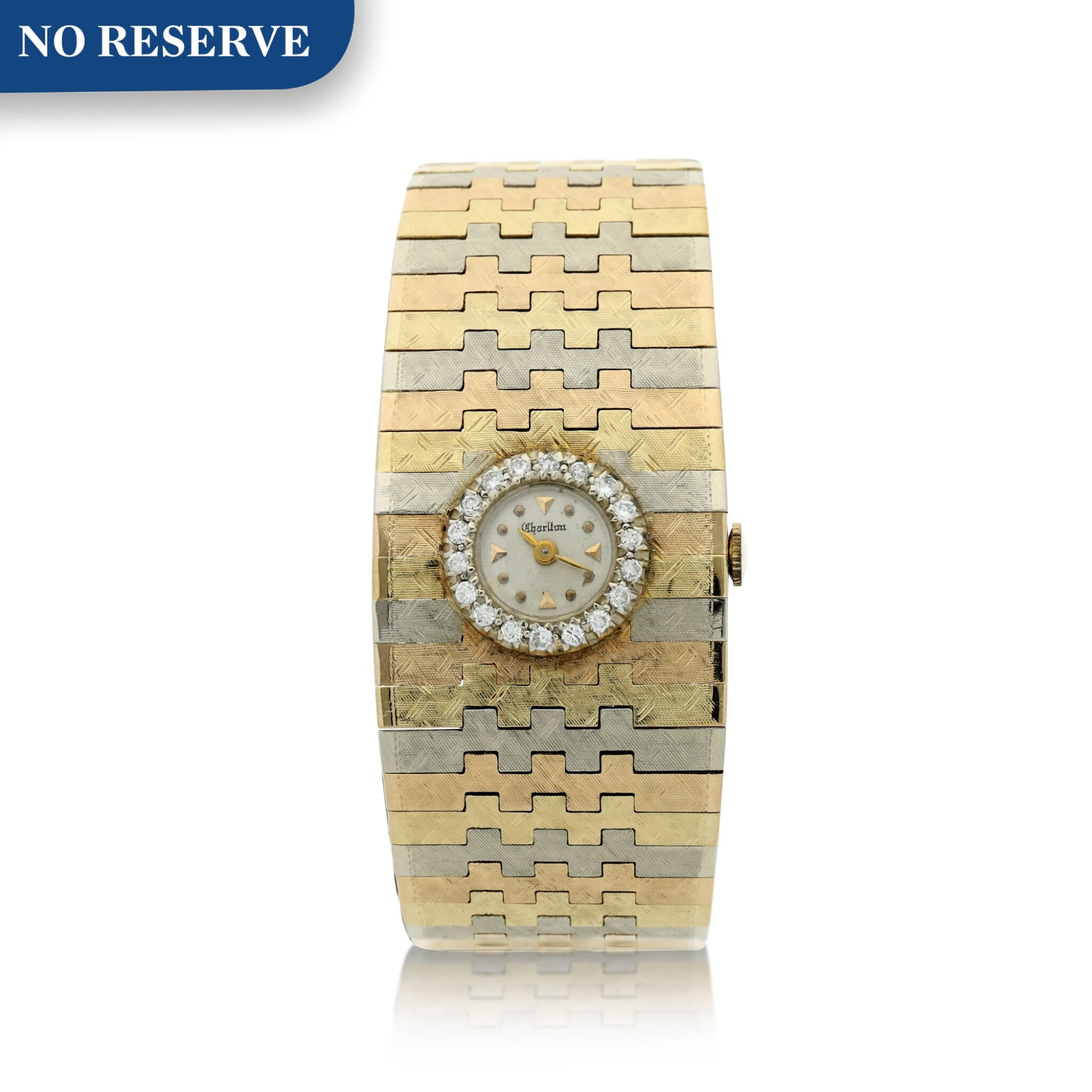RETAILED BY CHARLTON JEWELS, FORT LAUDERDALE, FLORIDA: A TRI-COLOR GOLD AND DIAMOND-SET BRACELET WATCH, CIRCA 1920