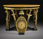 An Italian ebonised and parcel-gilt circular centre table, Milan early 19th century
