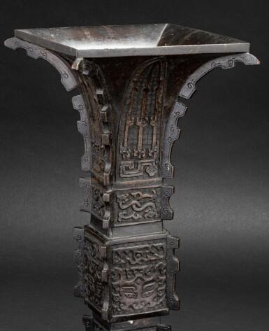 View 3. Thumbnail of Lot 79. Vase archaïsant en bronze patiné, gu Dynastie Qing, XVIIIE siècle | 清十八世紀 銅仿古紋出戟花觚 | A large bronze gu vase, Qing Dynasty, 18th century.