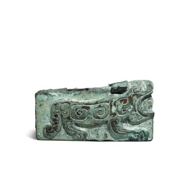 View 2. Thumbnail of Lot 24. An archaic bronze 'tiger' fitting, Shang dynasty | 商 青銅虎紋部件.