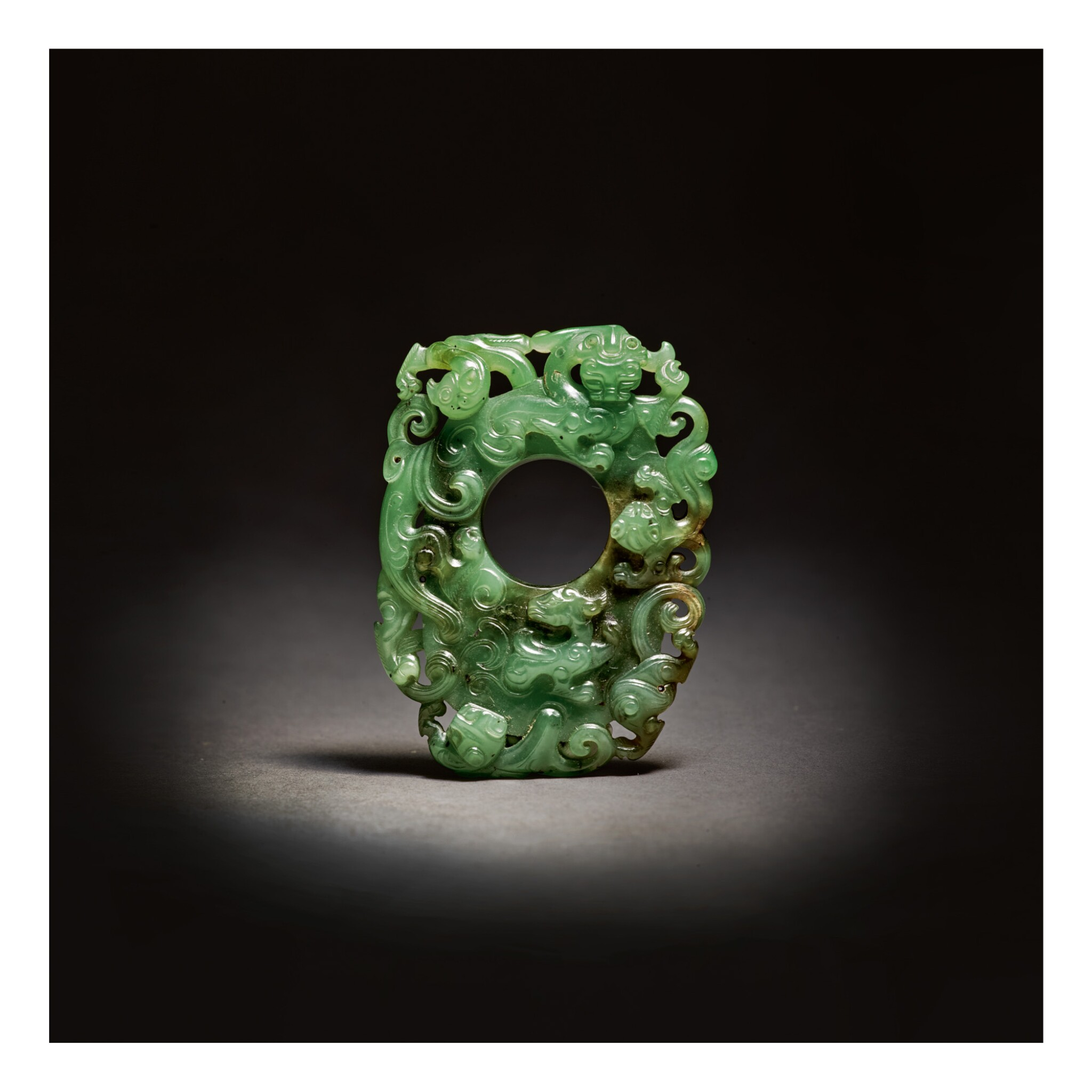 View full screen - View 1 of Lot 203.  A SUPERB ARCHAISTIC SPINACH-GREEN JADE PENDANT,  QING DYNASTY, QIANLONG PERIOD .