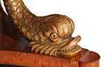 A REGENCY STYLE ROSEWOOD CIRCULAR DINING TABLE ON GILTWOOD DOLPHIN SUPPORTS, SECOND HALF 20TH CENTURY