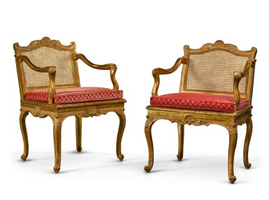 A PAIR OF LOUIS XV CANED CARVED GILTWOOD MUSIC CHAIRS CIRCA 1750