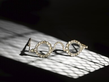 View full screen - View 1 of Lot 214. A pair of Mughal spectacles set with diamond lenses, in diamond-mounted frames, India, lenses circa 17th century, frames 19th century.