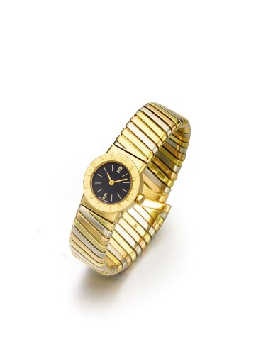 View 2. Thumbnail of Lot 43. BULGARI   REF BB 19 2T A LADY'S TRI COLOR GOLD TUBOGAS CUFF WATCH CIRCA 1985.