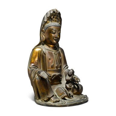 View 2. Thumbnail of Lot 43. A gilt-bronze figure of Guanyin and child, Ming / early Qing dynasty.