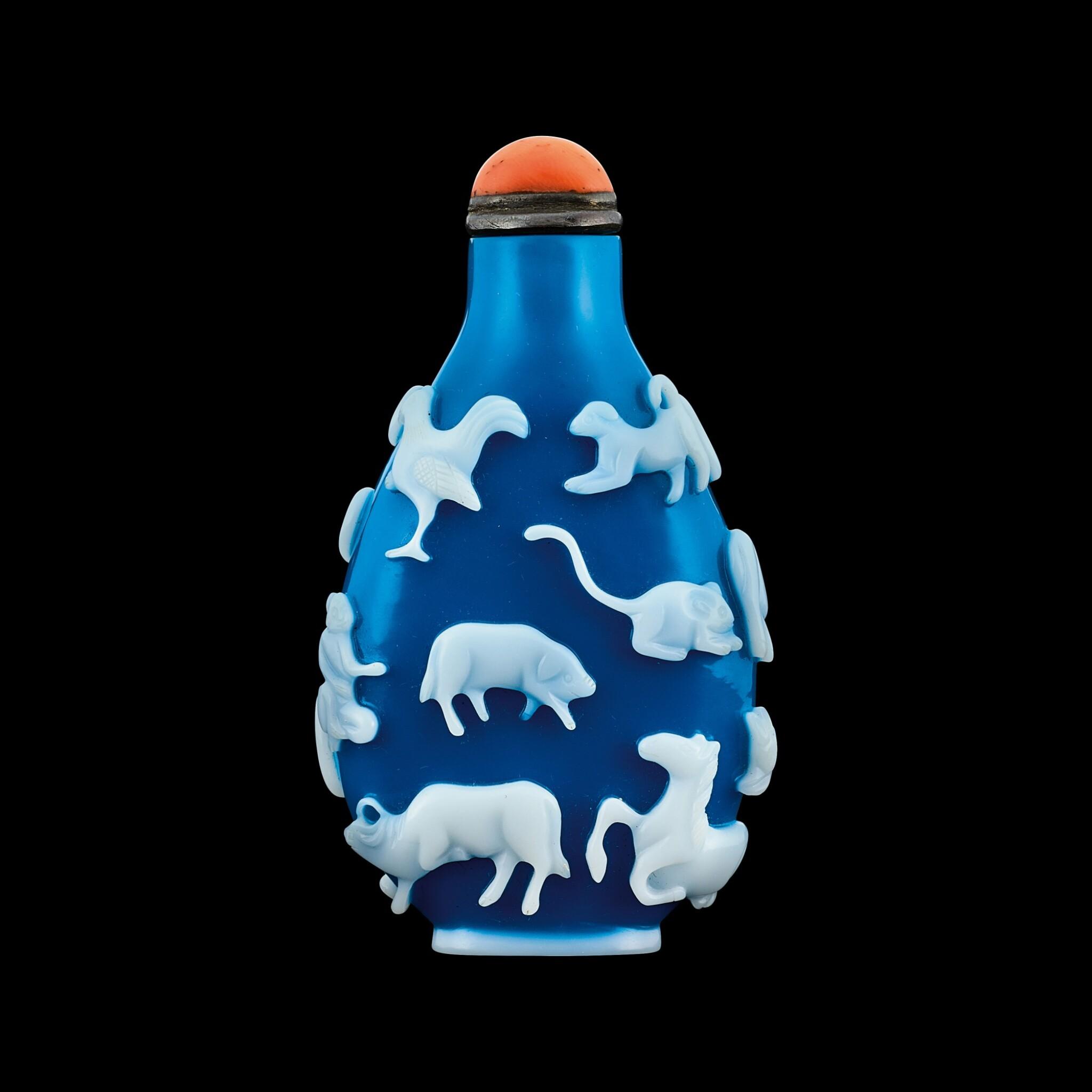 View full screen - View 1 of Lot 1017. A Yangzhou white overlay turquoise-blue glass 'twelve zodiac animals' snuff bottle Qing dynasty, 19th century | 清十九世紀 揚州作翠藍地套白料十二生肖圖鼻煙壺.