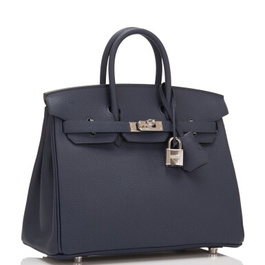View 2. Thumbnail of Lot 4. Hermès Bleu Nuit Birkin 25cm of Togo Leather with Palladium Hardware.