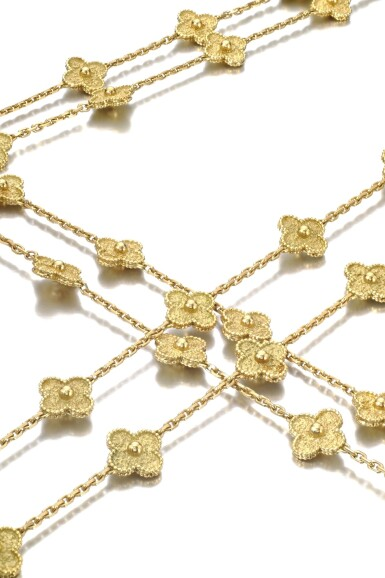 View 2. Thumbnail of Lot 622. Van Cleef & Arpels   Pair of gold sautoirs, 'Alhambra'   梵克雅寶   黃金「Alhambra」黃金長項鏈一對.