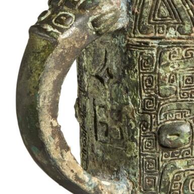 View 6. Thumbnail of Lot 5. An archaic bronze ritual wine vessel (Jue),  Late Shang dynasty | 商末 青銅饕餮紋爵.
