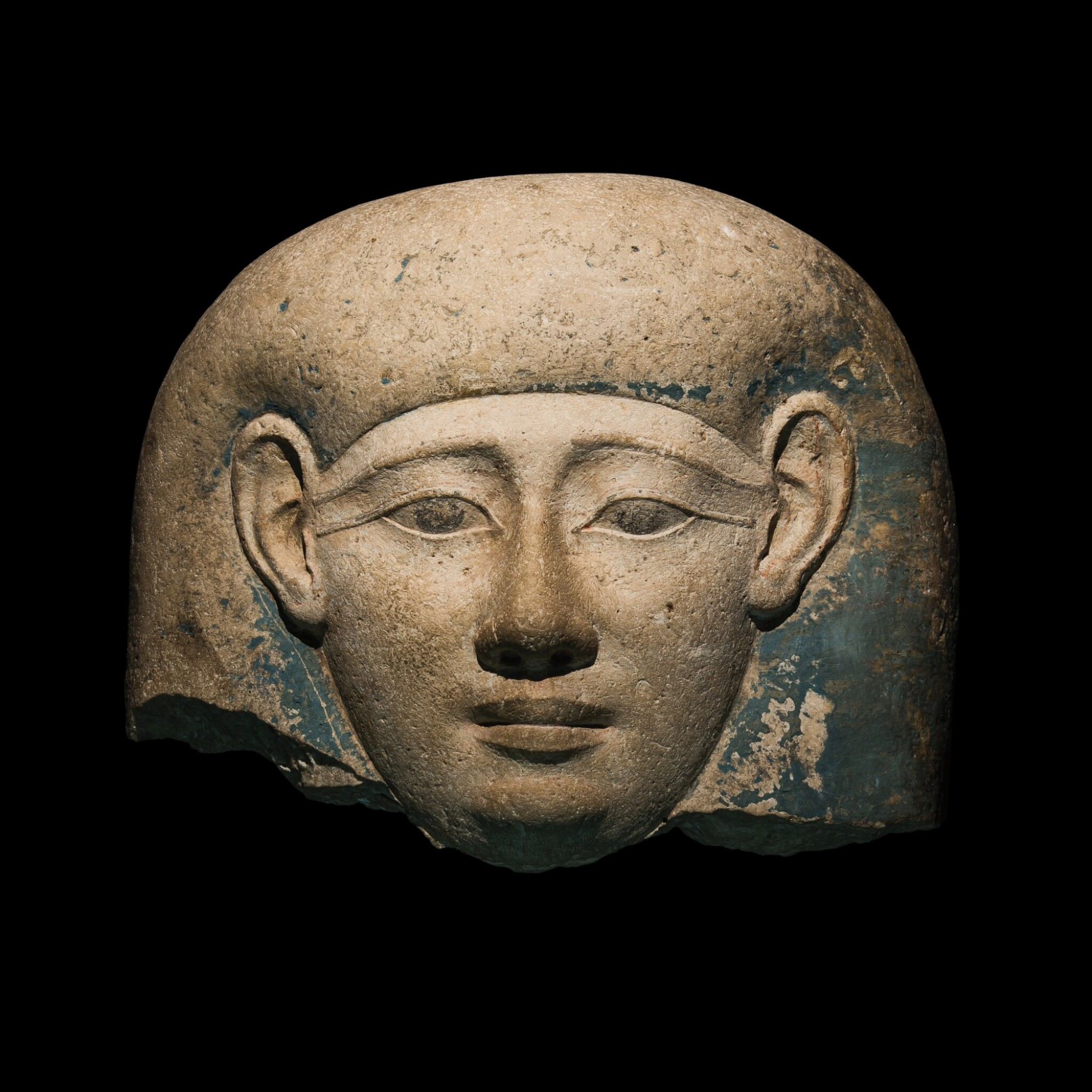 View 1 of Lot 45. An Egyptian Limestone Sarcophagus Mask, 30th Dynasty/early Ptolemaic Period, circa 380-250 B.C..