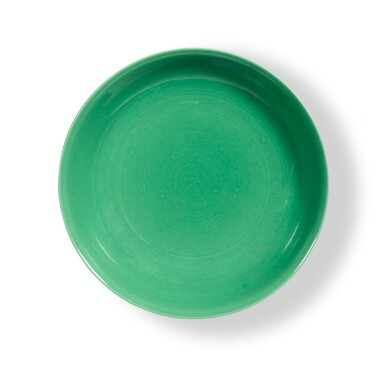 View 1. Thumbnail of Lot 19. A RARE GREEN-GLAZED SAUCER DISH,  QIANLONG INCISED MARK AND PERIOD | 清乾隆 蘋果綠釉盤 《大清乾隆年製》款.