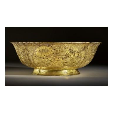 View 5. Thumbnail of Lot 202. A superb and important parcel-gilt silver 'lotus and pomegranate' bowl, Tang dynasty   唐 銀局部鎏金石榴蓮花紋花式大盌.