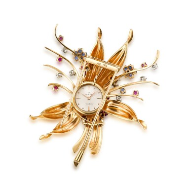 View 1. Thumbnail of Lot 1112. ROLEX | A YELLOW GOLD, DIAMOND, RUBY AND SAPPHIRE-SET BROOCH WITH TIMEPIECE, CIRCA 1960.