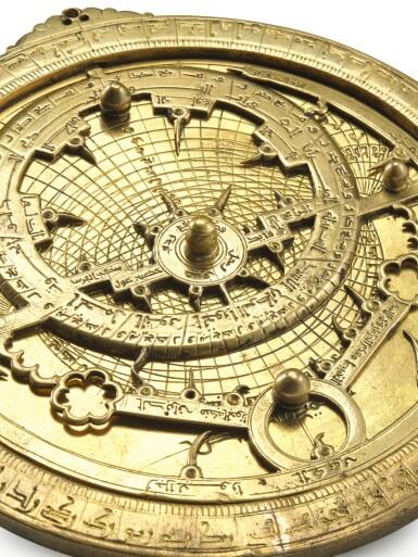 View 8. Thumbnail of Lot 66. A gilt-brass astrolabe signed by Ahmad ibn Abu 'Abdallah al-Qurtubi al-Yamani, North-East Spain, Tudela, dated 737 AH/1336-37 AD.