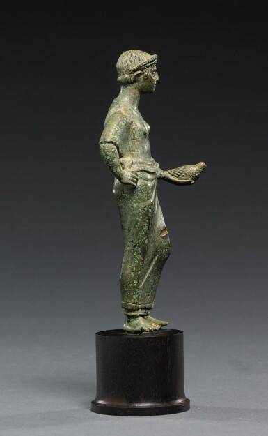 View 3. Thumbnail of Lot 11. AN ETRUSCAN BRONZE FIGURE OF A WOMAN, CIRCA 425-400 B.C..