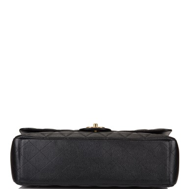 View 6. Thumbnail of Lot 60. Chanel Quilted Maxi Classic Double Flap Bag of Black Caviar Leather with Gold Hardware.