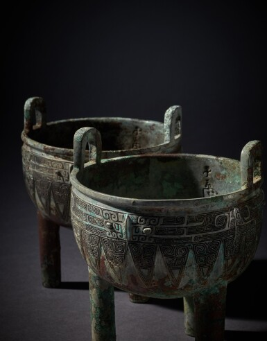 View 8. Thumbnail of Lot 1. An extremely rare pair of archaic bronze ritual food vessels (Ding), Late Shang dynasty   商末 子龔鼎一對.