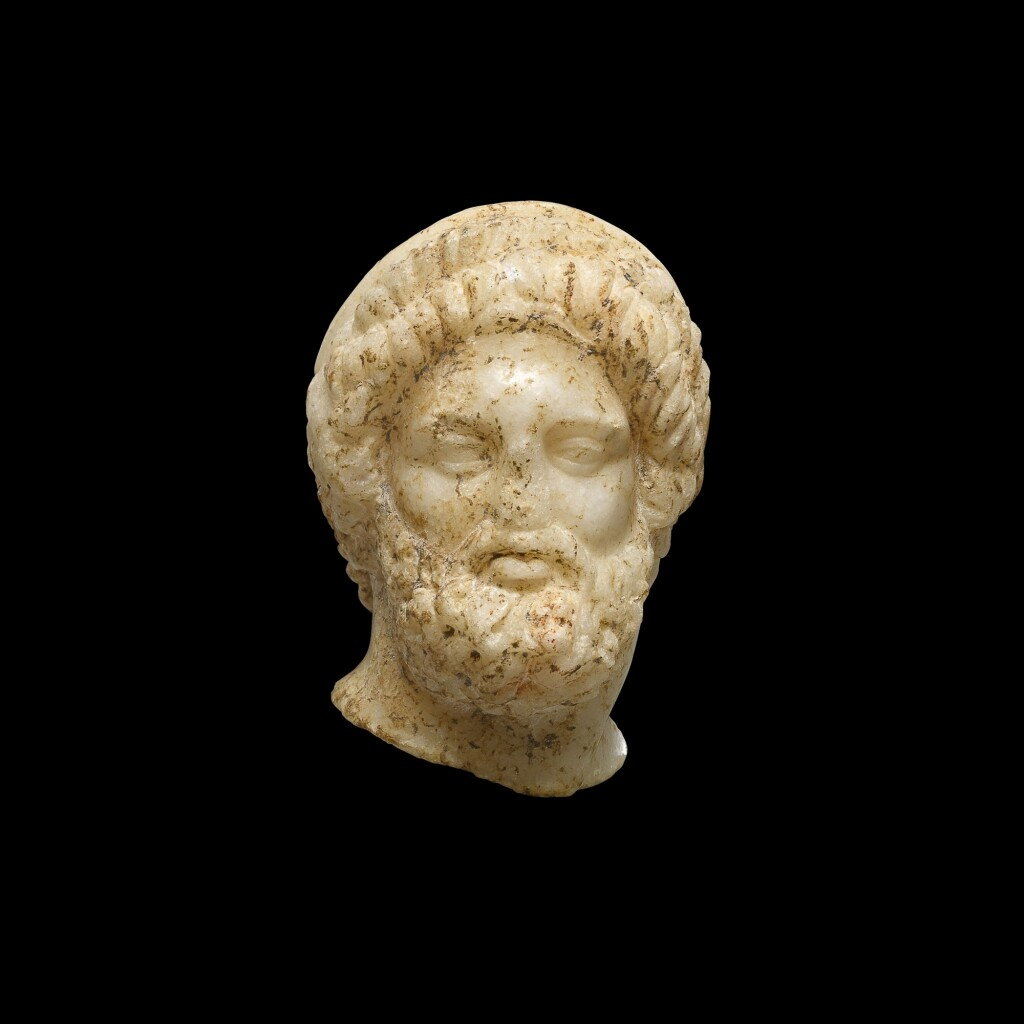 A MARBLE HEAD OF A MAN OR GOD, 1ST CENTURY B.C/1ST CENTURY A.D.
