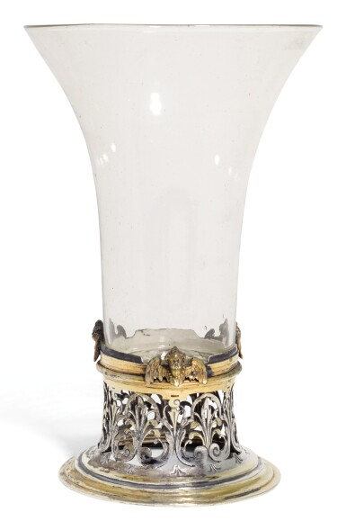 View 1. Thumbnail of Lot 142. AN ITALIAN GLASS BEAKER WITH CONTINENTAL PARCEL-GILT SILVER FOOT MOUNT, UNMARKED, CIRCA 1630.