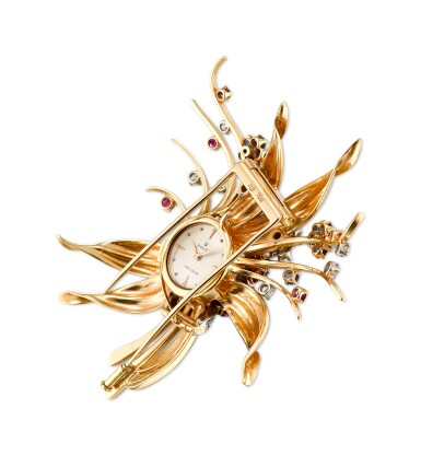 View 2. Thumbnail of Lot 1112. ROLEX | A YELLOW GOLD, DIAMOND, RUBY AND SAPPHIRE-SET BROOCH WITH TIMEPIECE, CIRCA 1960.
