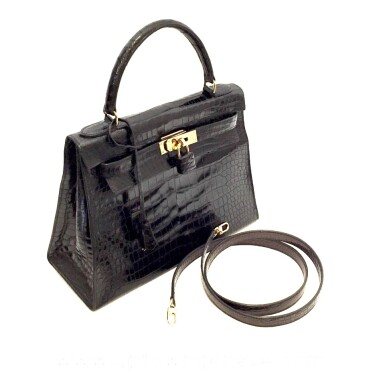 View 7. Thumbnail of Lot 743. HERMÈS | BLACK KELLY 28 IN SHINY CROCODILE WITH GOLD HARDWARE, 1962.