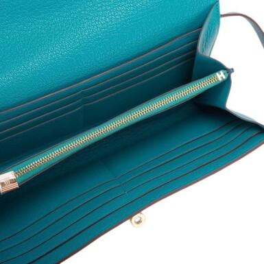 View 6. Thumbnail of Lot 23. Hermès Blue Paon Chevre Leather Kelly Longue Wallet.