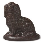 AN ENGLISH BROWN-GLAZED STONEWARE MODEL OF A SEATED SPANIEL, 19TH CENTURY