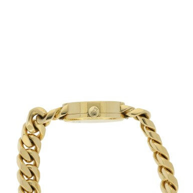 View 4. Thumbnail of Lot 221. REFERENCE 5026/1 A LADY'S YELLOW GOLD BRACELET WATCH WITH TIGER EYE DIAL, CIRCA 1990'S.