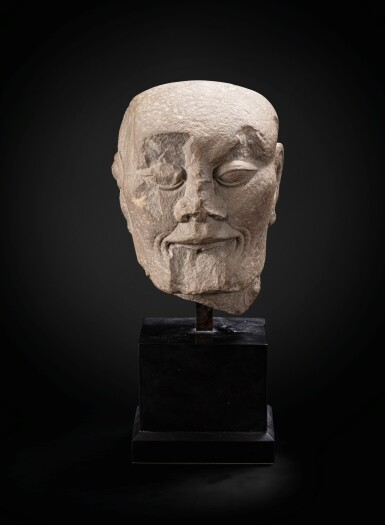 View 3. Thumbnail of Lot 195. A carved limestone head of a fasting Luohan Song dynasty   宋 石灰石雕羅漢首像.