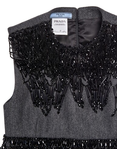 View 4. Thumbnail of Lot 43. PRADA   EMBROIDERED WOOL PLEATED SKIRT, BEADED FRINGE TOP AND VANITY BRACELET, WORN BY FIA LJUNGSTROM.