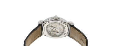 View 5. Thumbnail of Lot 92. Reference 10540   A white gold and diamond-set oval wristwatch, Circa 1994.