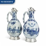 A PAIR OF CHINESE BLUE AND WHITE PORCELAIN EWERS WITH SILVER MOUNTS, THE PORCELAIN MID 17TH CENTURY; THE SILVER DUTCH, 19TH CENTURY