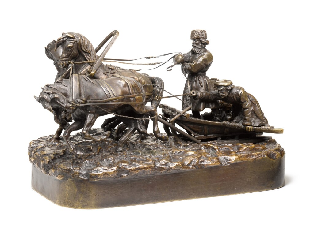 A WINTER TROIKA RIDE: A SMALL BRONZE FIGURAL GROUP, AFTER THE MODEL BY EVGENY NAPS, 1880