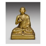 A GILT COPPER ALLOY FIGURE DEPICTING THE FIRST PANCHEN LAMA, LOBZANG CHOKYI GYALTSEN,  TIBET, 17TH/18TH CENTURY