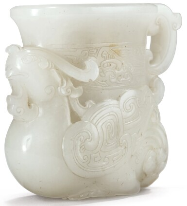 View 1. Thumbnail of Lot 58. RARE ET IMPORTANTE COUPE EN JADE BLANC ET ROUILLE DYNASTIE QING, ÉPOQUE QIANLONG | 清乾隆 青白玉夔鳳紋觥 | A very rare small white and russet jade vessel in the form of a phoenix, Qing Dynasty, Qianlong period.