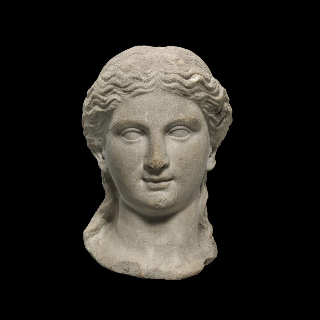 A ROMAN MARBLE HEAD OF A WOMAN, CIRCA EARLY 1ST CENTURY A.D.