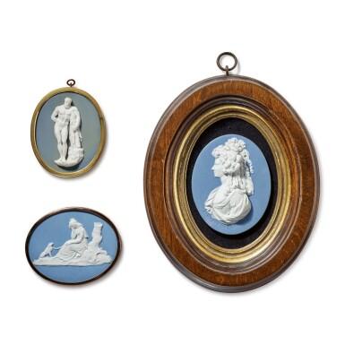 A GROUP OF THREE WEDGWOOD OR WEDGWOOD AND BENTLEY JASPERWARE PORTRAIT MEDALLIONS CIRCA 1780-90