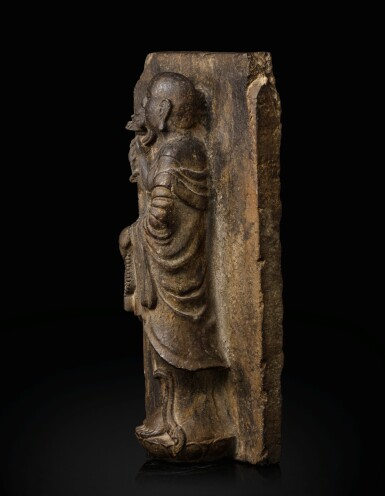 View 2. Thumbnail of Lot 51. A rare limestone carving of a Buddhist acolyte, possibly Jianglong Luohan Northern Song dynasty, 10th-11th century   北宋十至十一世紀 石灰石浮雕或為降龍羅漢像.