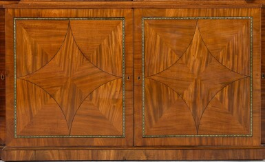 View 3. Thumbnail of Lot 59. A Regency brass inlaid and ebony strung mahogany breakfront library bookcase, circa 1815.