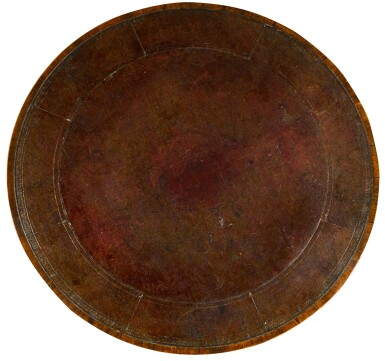 View 2. Thumbnail of Lot 58. A Regency parcel-gilt rosewood and marquetry library drum table, circa 1815.